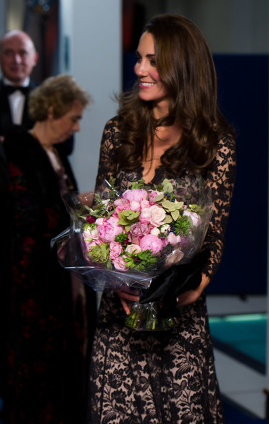 Duchess of Cambridge, Kate Middleton collecting flowers at the 'War Horse' premiere 2012